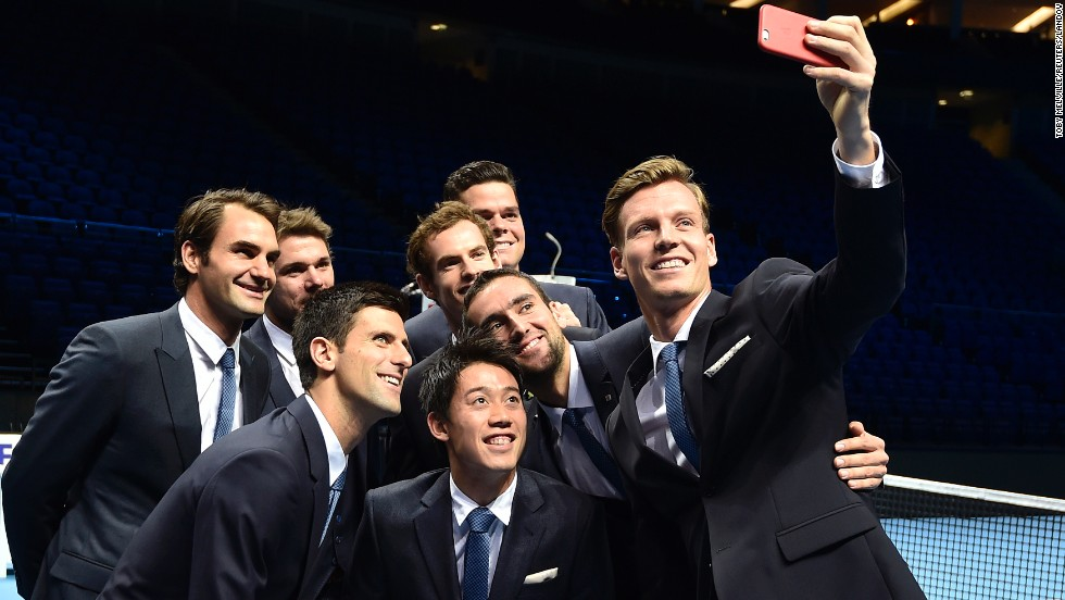 "Federer joins the other eight finalists in the ATP World Tour Finals for a ""selfie"" ahead of the action at the 02 Arena."