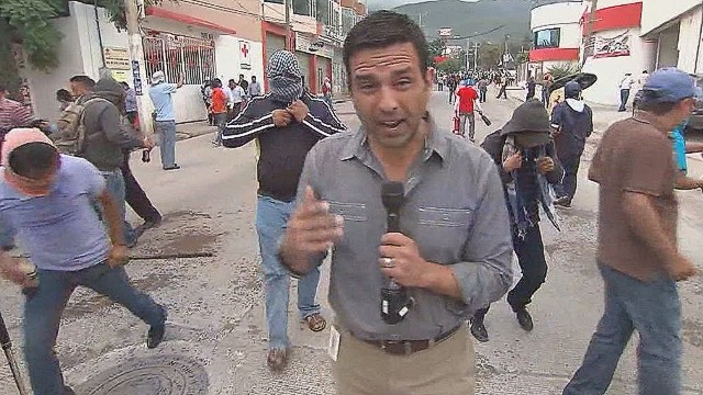 tell romo hit with teargas in mexico protest_00001022.jpg
