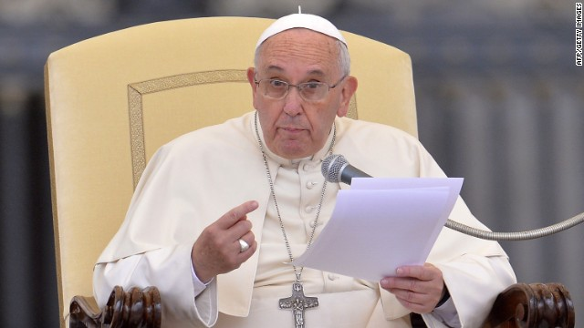 Pope Francis gestures as he reads speech during his weekly open-air general audience in St. Peter's Square at the Vatican on November 12, 2014. AFP PHOTO / ANDREAS SOLAROANDREAS SOLARO/AFP/Getty Images