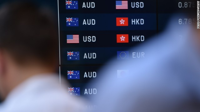 Caption:Pedestrians pass by currency prices on display at a bank on a street in Sydney on October 7, 2014. The Australian dollar hit a four-year-low of 86.43 US cents in New York last week as Australia's economy struggles to transition away from resources-led growth following an unprecedented boom in mining investment that is expected to fall-off sharply over the next year. AFP PHOTO/Peter PARKS (Photo credit should read PETER PARKS/AFP/Getty Images)