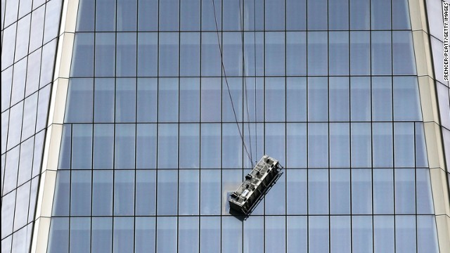 NEW YORK, NY - NOVEMBER 12:  A scaffold carrying two workers hangs 69 floors up at One World Trade Center on November 12, 2014 in New York City.  The workers were washing windows 69 floors up soon after One World Trade Center, the tallest building in the Western Hemisphere, opened. (Photo by Spencer Platt/Getty Images)
