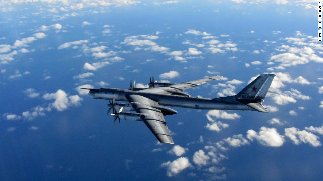 FILE - This is a Wednesday, Oct. 29, 2014 file photo provided by Britain's Royal Air Force of a Russian military long range bomber aircraft photographed by an intercepting RAF quick reaction Typhoon (QRA) as it flies in international airspace. Russia's defense minister says the military will conduct regular long-range bomber patrols, ranging from the Arctic Ocean to the Caribbean and the Gulf of Mexico. Sergei Shoigu's statement comes as NATO has reported a spike in Russian military flights over the Black, Baltic and North seas as well as the Atlantic Ocean. It reflects Moscow's increasingly tough posture amid tensions with the West over Ukraine.(AP Photo/Royal AIr Force)