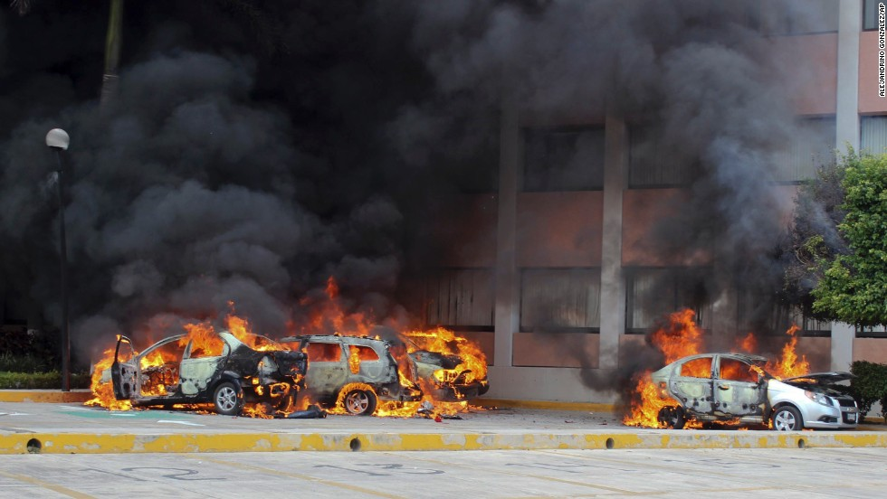 "Cars burn in front of the state Congress building in Chilpancingo on Wednesday, November 12. <a href=""http://www.cnn.com/2014/11/04/world/americas/mexico-missing-students/index.html"">Authorities have arrested Iguala Mayor Jose Luis Abarca</a>, called the ""probable mastermind"" in the mass abduction, and his wife, Maria de los Angeles Pineda."