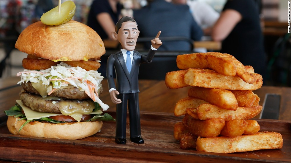 "The ""Big Obama Burger"" created by Windmill & Co. includes two Angus beef patties, cheese (of course), onions, onion rings, spinach, tomato, cucumbers and mustard."