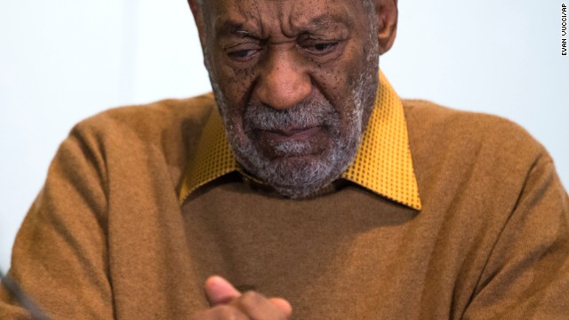 """In this photo taken Nov. 6, 2014, entertainer Bill Cosby pauses during a news conference about the upcoming exhibit, Conversations: African and African-American Artworks in Dialogue, at the Smithsonian's National Museum of African Art in Washington. The Smithsonian Institution is mounting a major showcase of African-American art and African art together in a new exhibit featuring the extensive art collection of Bill and Camille Cosby. More than 60 rarely seen African-American artworks from the Cosby collection will join 100 pieces of African art at the National Museum of African Art. The exhibit """"Conversations: African and African American Artworks in Dialogue,"""" opens Sunday and will be on view through early 2016. (AP Photo/Evan Vucci)"""