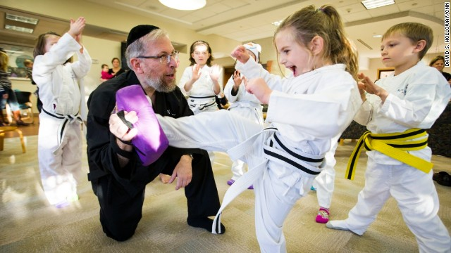 CNN Hero Rabbi Elimelech Goldberg teaches at the Kids Kicking Cancer Center in Detroit, Michigan on October 28.