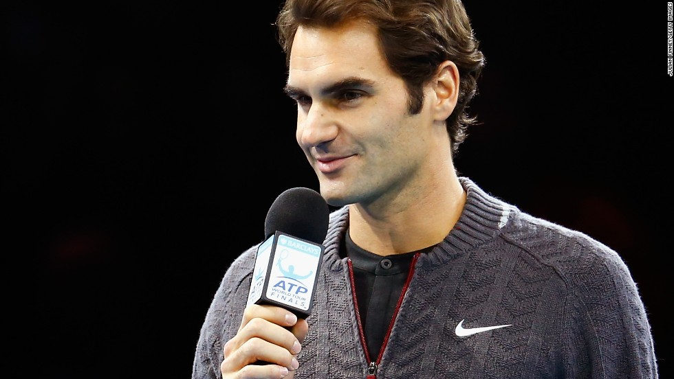 Federer tells fans he has had to pull out of the title match against Djokovic with a back problem.