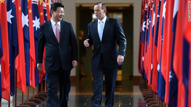 China's President Xi Jinping (L) and Australia's Prime Minister Tony Abbott walk together as they leave the House of Representatives at Parliament House in Canberra on November 17, 2014. Xi is visiting Canberra after attending the G20 Summit in Brisbane over the weekend. AFP PHOTO / POOL / Lukas CochLUKAS COCH/AFP/Getty Images