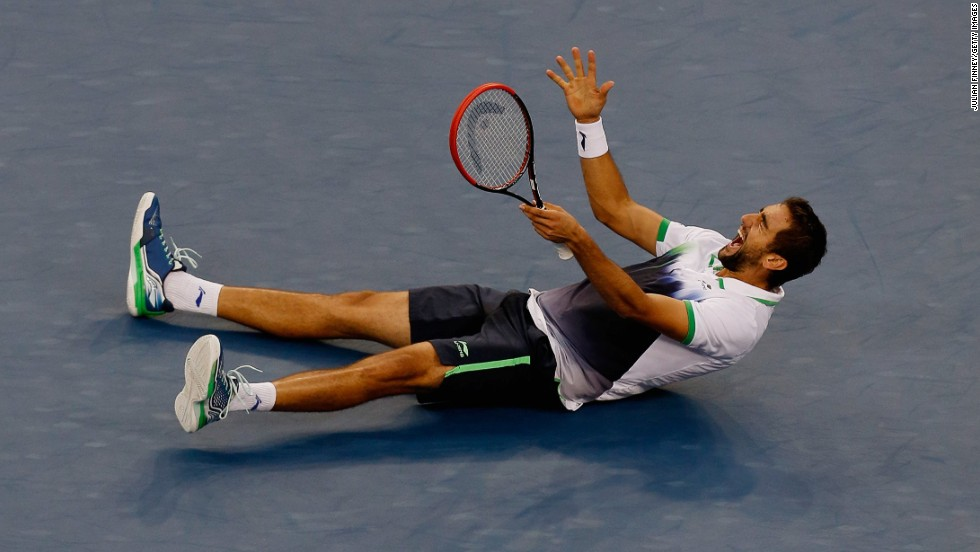 Cilic falls to the floor in joy after defeating Japan's Kei Nishikori to win the U.S. Open in September.