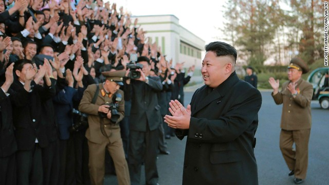 his undated photo released by North Korea's official Korean Central News Agency (KCNA) on November 15, 2014 shows North Korean leader Kim Jong-Un (front R) visiting the February 20 Factory of the Korean People's Army which produces foodstuff for servicemen, at an undisclosed location. Meanwhile, North Korea on November 15 warned of retaliatory strikes days after South Korea fired warning shots at a North Korean patrol near the border. REPUBLIC OF KOREA OUT AFP PHOTO / KCNA via KNS  THIS PICTURE WAS MADE AVAILABLE BY A THIRD PARTY. AFP CAN NOT INDEPENDENTLY VERIFY THE AUTHENTICITY, LOCATION, DATE, AND CONTENT OF THIS IMAGE. THIS PHOTO IS DISTRIBUTED EXACTLY AS RECEIVED BY AFP.