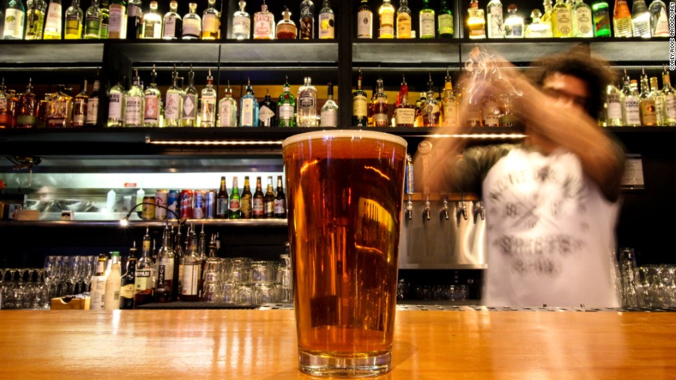 With so many great beers available, why drink anything else? Bartender David Hall serves a pint of Boneyard's RPM IPA, one of many rotating beers at White Owl Social Club.
