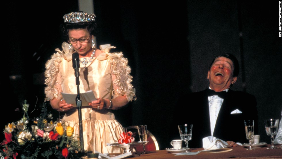 President Ronald Reagan laughing at the Queen's speech  during a state dinner in San Francisco, California in 1983.