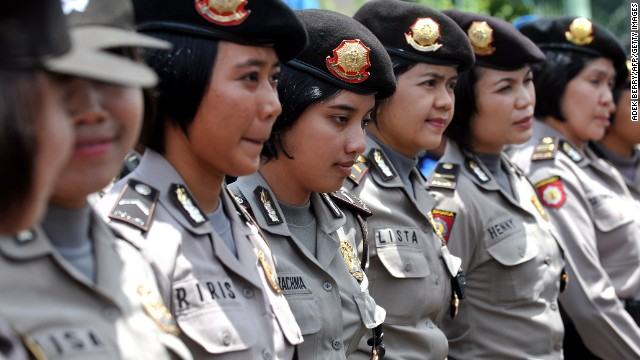 Indonesian policewomen stand guard while Indonesian workers of the All-Indonesia workers union (SPSI) hold a protest against the government's plan to hike fuel prices in Jakarta on March 29, 2012. Thousands of Indonesian protesters rallied on March 29 against a planned fuel price hike, ahead of a decision on cutting subsidies which the government says the nation can't afford. AFP PHOTO / ADEK BERRY (Photo credit should read ADEK BERRY/AFP/Getty Images)