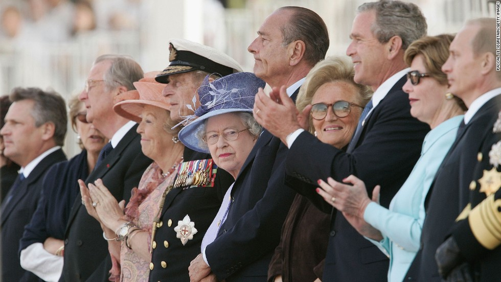 Queen Margrethe of Denmark, Prince Philip, Queen Elizabeth II, French President Jacques Chirac, Bernadette Chirac, U.S President George W Bush, First Lady Laura Bush and Russian President Vladimir Putin attend the commemoration ceremony on the 60th anniversary of D-Day, June 6, 2004 in Arromanches, France.