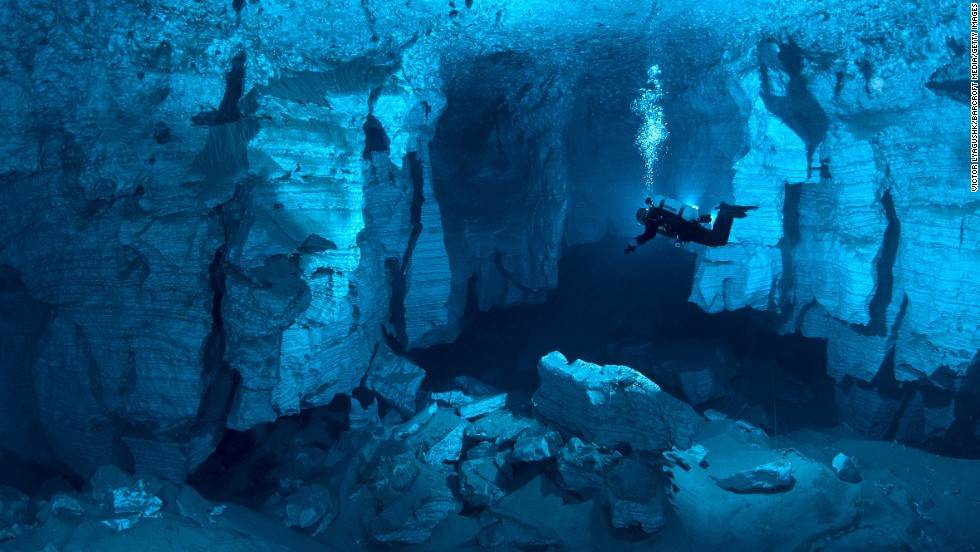Cave divers explore the Orda Cave in Russia's western Urals region. Cave diving is one of the most dangerous kinds of diving or caving in the world and requires specialized equipment and training.