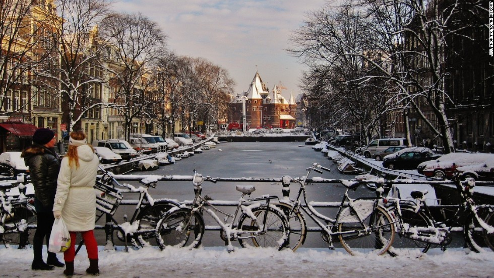 "The <a href=""http://ireport.cnn.com/docs/DOC-1140065"">Oude Kerk</a> stands just beyond an icy bridge in Amsterdam. The 800-year-old building was constructed in the early fourteenth century as a <a href=""http://www.oudekerk.nl/en/"" target=""_blank"">Roman Catholic church</a>, but also has Protestant influences in its architecture."