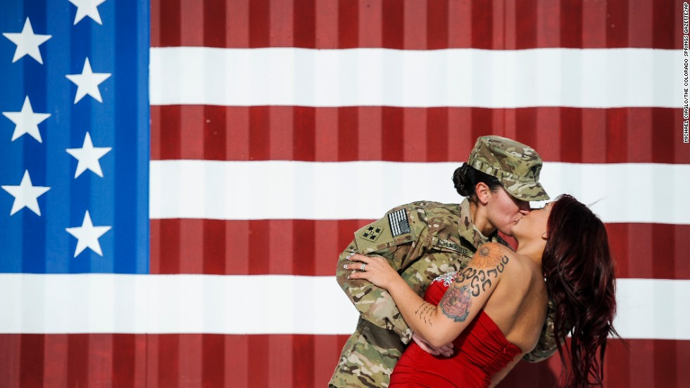 U.S. Army Spc. Sabryna Schlagetter kisses her wife, Cheyenne, after returning home to Fort Carson, Colorado, with other members of the 4th Infantry Brigade Combat Team on Friday, November 14. The couple married on Valentine's Day this year before Sabryna deployed to Afghanistan.