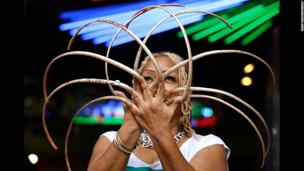 "Ayanna Williams shows off her 23-inch nails at a book launch in London on Wednesday, November 19. Williams is featured in the book, a compendium of strange-but-true facts entitled ""Ripley's Believe It or Not!: Reality Shock!"""