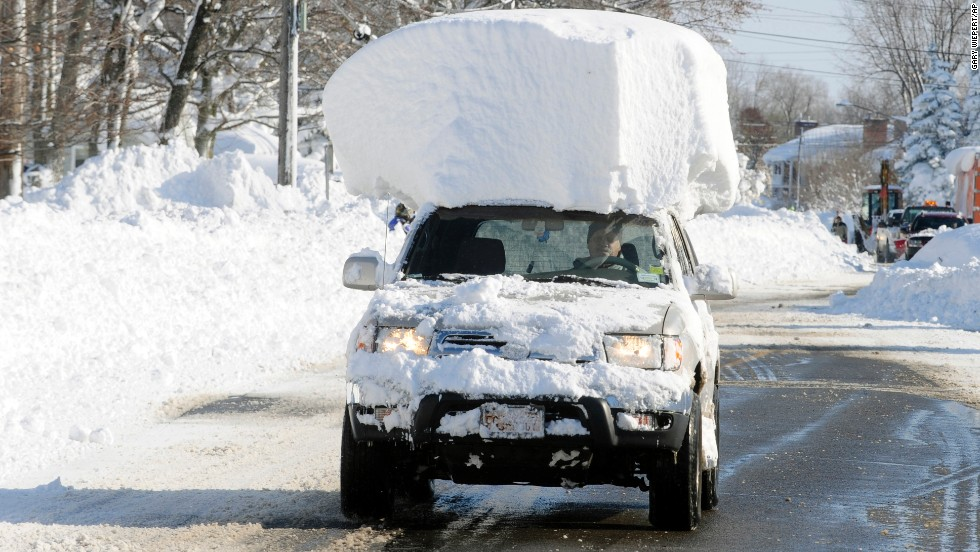 "A vehicle with a large chunk of snow on its roof drives along Route 20 after a massive snowfall in Lancaster, New York, on Wednesday, November 19. A ferocious storm dumped large piles of snow on parts of upstate New York, trapping residents in their homes and stranding motorists on roadways, as snowstorms and record-low temperatures <a href=""http://www.cnn.com/2014/11/19/us/gallery/wintry-weather/index.html"">hit much of the country.</a>"