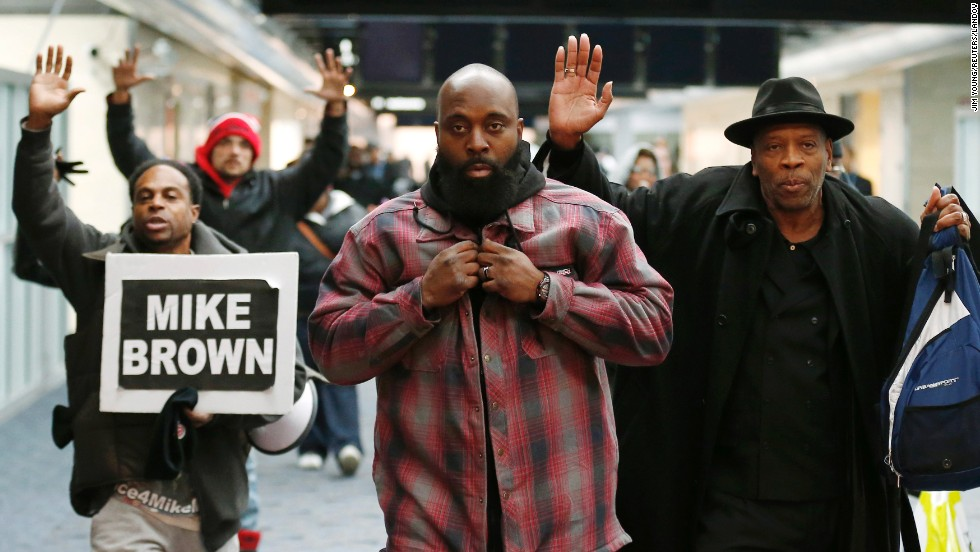 "Michael Brown Sr., center, is greeted by supporters at the airport in St. Louis, Missouri, on Friday, November 14. Brown, the father of slain teenager Michael Brown Jr., had just returned from Geneva, Switzerland, where he and his son's mother <a href=""http://www.cnn.com/2014/11/11/us/ferguson-brown-parents-u-n-/"">spoke to the United Nations Committee Against Torture.</a> The committee also works against cruel or degrading treatment or punishment by government authorities. ""We need the world to know what's going on in Ferguson and we need justice,"" the teen's mother, Lesley McSpadden, told CNN."