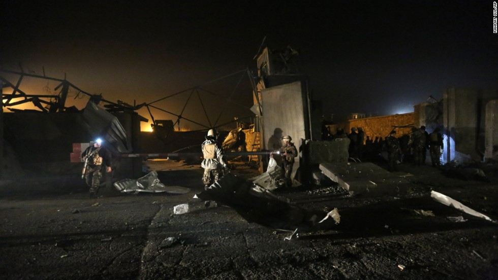 Afghan security forces inspect the site of a suicide attack in Kabul, Afghanistan, on Wednesday, November 19.
