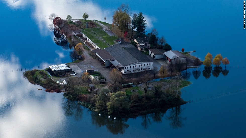 "An aerial view shows a farm surrounded by floodwaters Sunday, November 16, near the Swiss village of Magadino. <a href=""http://www.cnn.com/2014/11/14/world/gallery/week-in-photos-1114/index.html"">See last week in 32 photos</a>"