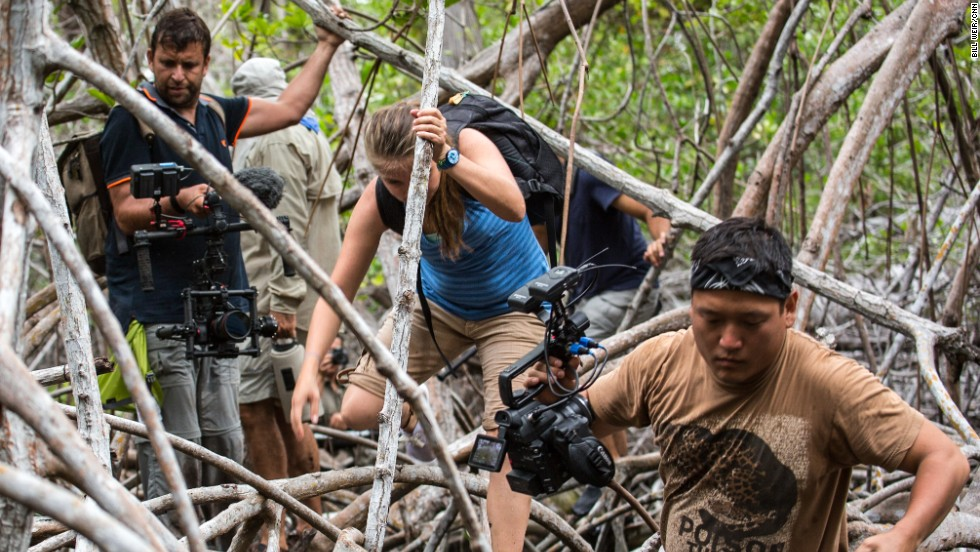 """The Wonder List"" crew traverses through the wild mangroves trees on the island of Isabela in the Galapagos Islands. From left: Philip Bloom, Francesca Cunninghame and Cassius Kim."