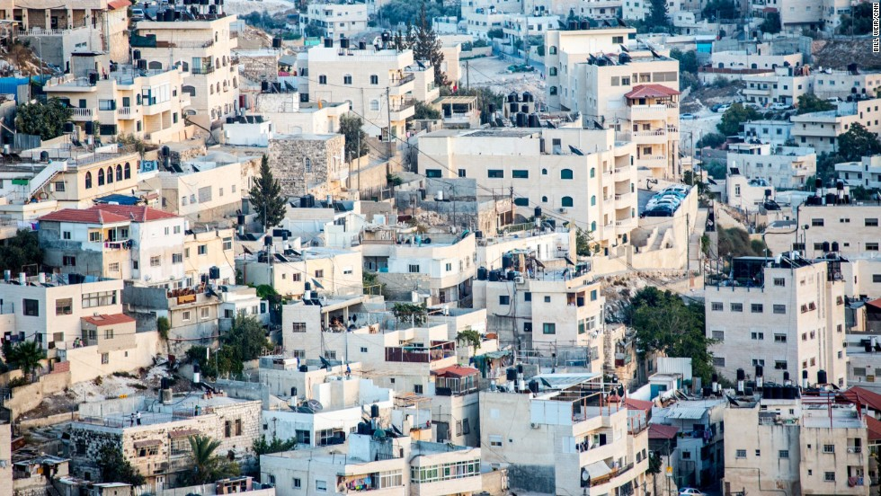 Cascades of white buildings seemingly flow along the hills of Jerusalem.