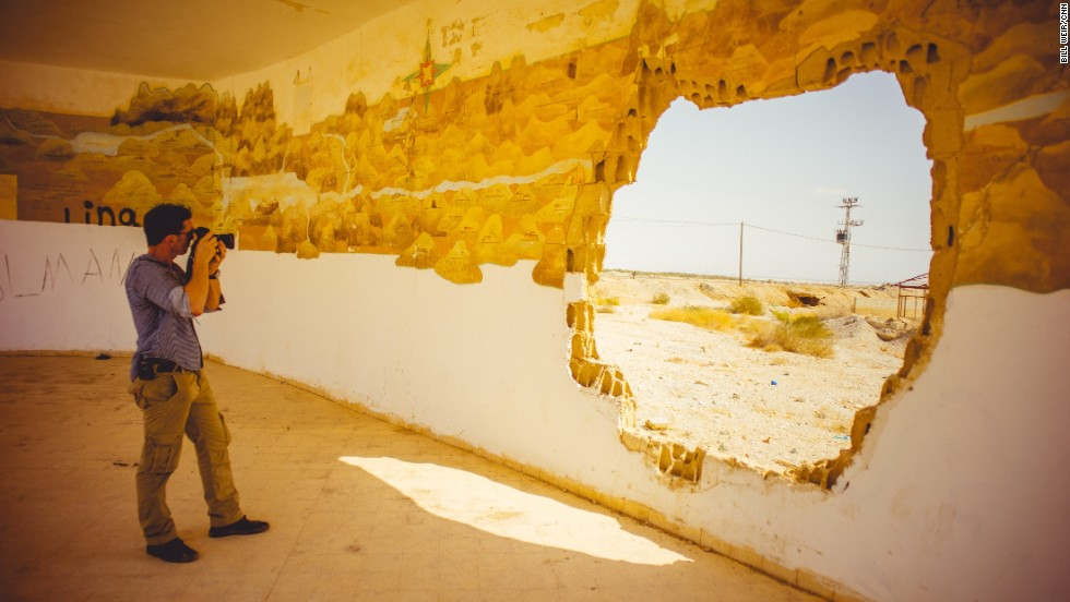Bill Weir snaps pictures at the old Lido hotel, now abandoned, on the northern Israeli shores of the Dead Sea.