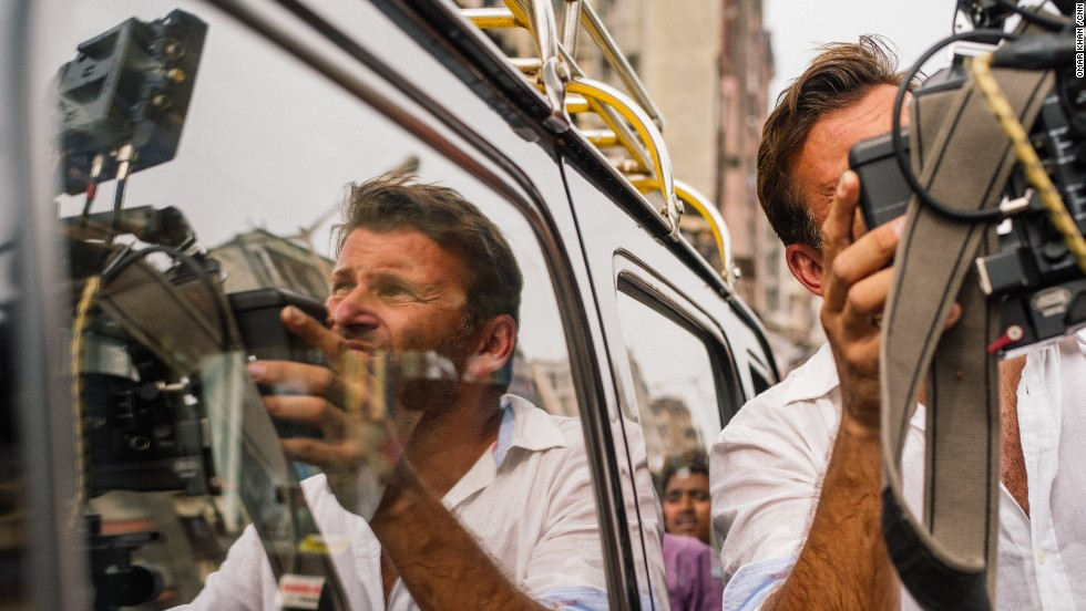 Philip Bloom is reflected in a car window while shooting around Mumbai.
