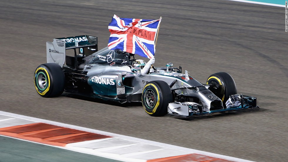 Get the flags out! Hamilton wins the 2014 Abu Dhabi Grand Prix and with it a second world title.