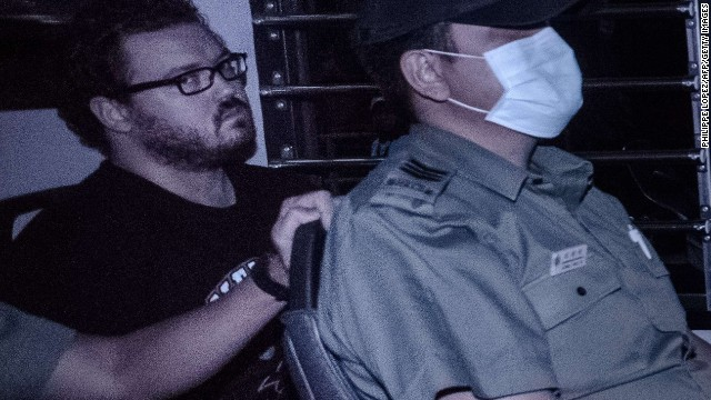 British banker Rurik Jutting seen in a police van November 10, 2014.