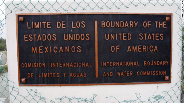 A plaque designates the official border between the United States and Mexico.
