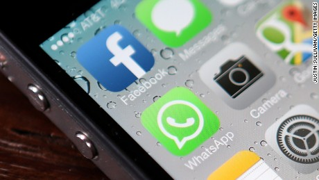 SAN FRANCISCO, CA - FEBRUARY 19:  The Facebook and WhatsApp app icons are displayed on an iPhone 5 on February 19, 2014 in San Francisco City.(Photo illustration by Justin Sullivan/Getty Images)