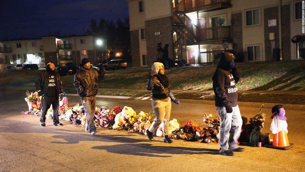 Residents begin to gather at the Michael Brown memorial ahead of the grand jury announcement.