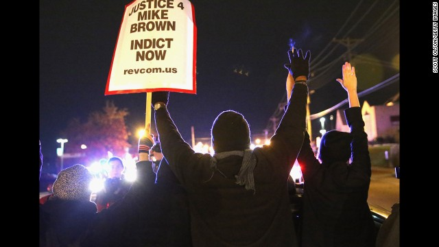 FERGUSON, MO - NOVEMBER 24:  Demonstrators are confronted by police as they block a street during a protest ahead of the grand jury announcement on November 24, 2014 in Ferguson, Missouri. Ferguson has been struggling to return to normal after Brown, an 18-year-old black man, was killed by Darren Wilson, a white Ferguson police officer, on August 9. His death has sparked months of sometimes violent protests in Ferguson. A grand jury is expected announce today if Wilson should be charged in the shooting.  (Photo by Scott Olson/Getty Images)