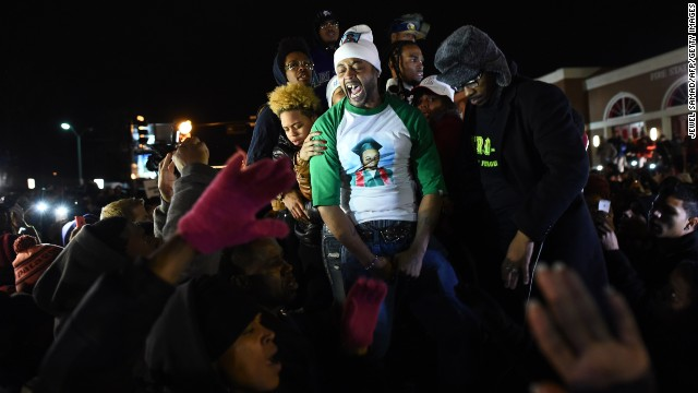 Demonstrators gather outside the police station in Ferguson, Missouri, on Monday, November 24.