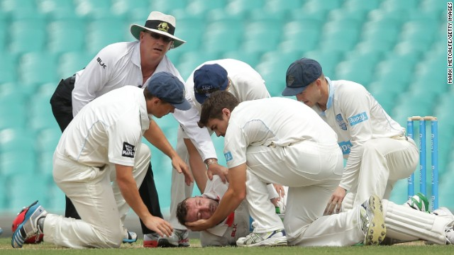 YDNEY, AUSTRALIA - NOVEMBER 25: (EDITORS NOTE: Image contains graphic content.) Phillip Hughes of South Australia is helped by New South Wales players after falling to the ground after being struck in the head by a delivery during day one of the Sheffield Shield match between New South Wales and South Australia at Sydney Cricket Ground on November 25, 2014 in Sydney, Australia. (Photo by Mark Metcalfe/Getty Images) ***BESTPIX***
