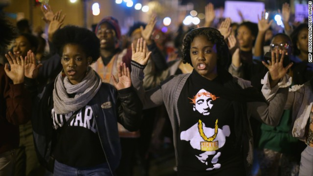 WASHINGTON, DC - NOVEMBER 24: Hundreds of demonstrators, many of them Howard University students, march down the middle of U Street Northwest after a grand jury did not intict the white police officer who killed an unarmed black teenager in Missouri November 24, 2014 in Washington, DC. A St. Louis County grand jury has decided to not indict Ferguson police Officer Darren Wilson in the shooting of Michael Brown that sparked riots in Ferguson, Missouri in August. (Photo by Chip Somodevilla/Getty Images)