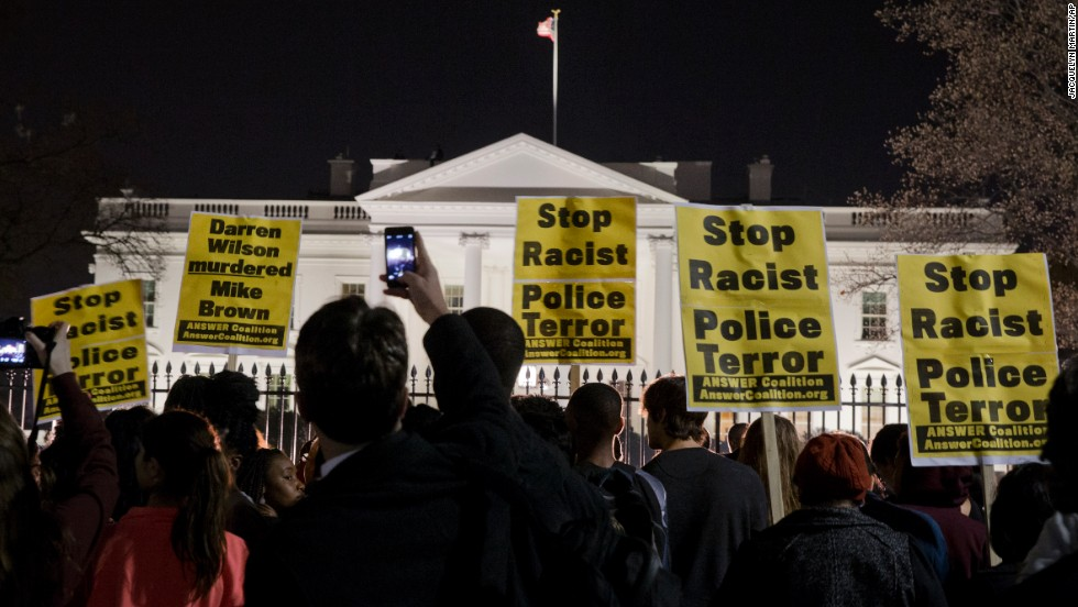 A crowd in Washington gathers outside the White House on November 24.