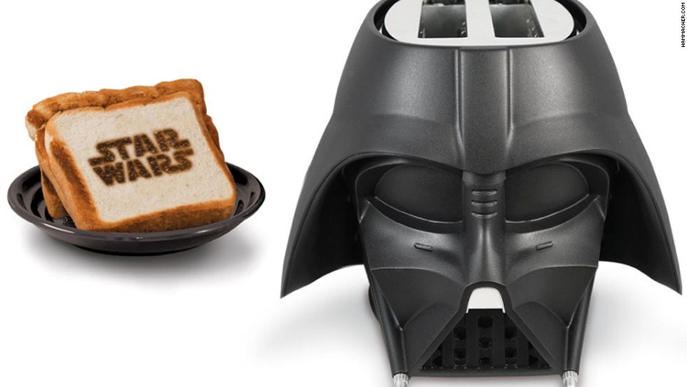 "<strong>For the Force:</strong> While we count down the days until ""Star Wars: Episode VII -- The Force Awakens"" opens in December 2015, this toaster will supply a breakfast that's been to the Dark Side and back. The Darth Vader toaster will crisp the edges of each bread slice and imprint the ""Star Wars"" logo on both sides.   ($49.95)"