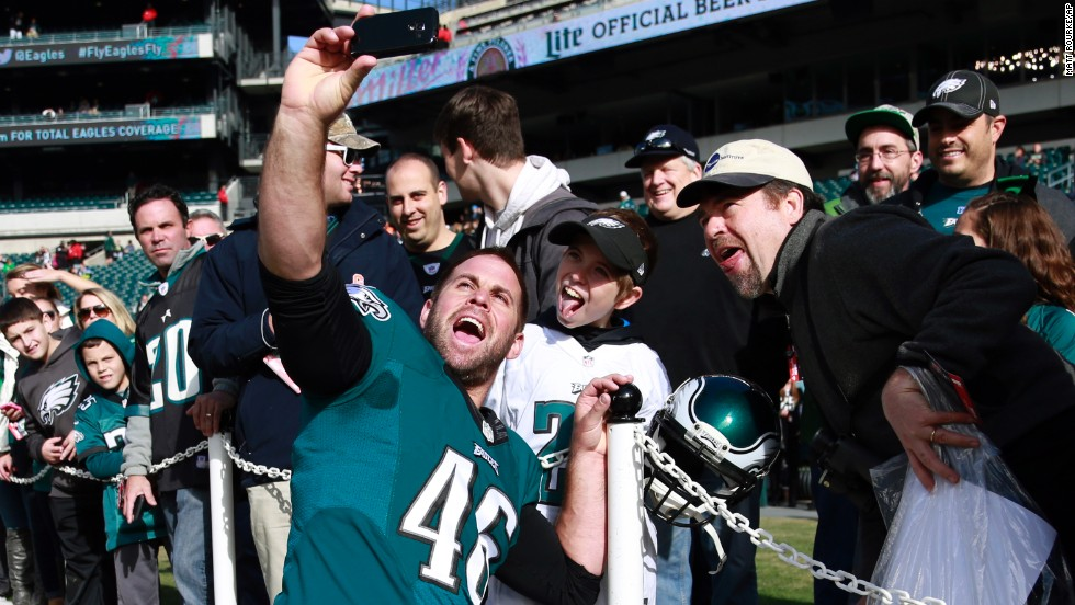 Jon Dorenbos, a long snapper for the NFL's Philadelphia Eagles, snaps a selfie with home fans before taking on the Tennessee Titans on Sunday, November 23.