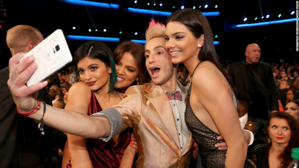 Frankie Grande, brother of pop star Ariana Grande, takes a selfie with television personalities Kylie Jenner, Khloe Kardashian and Kendall Jenner at the American Music Awards on Sunday, November 23.