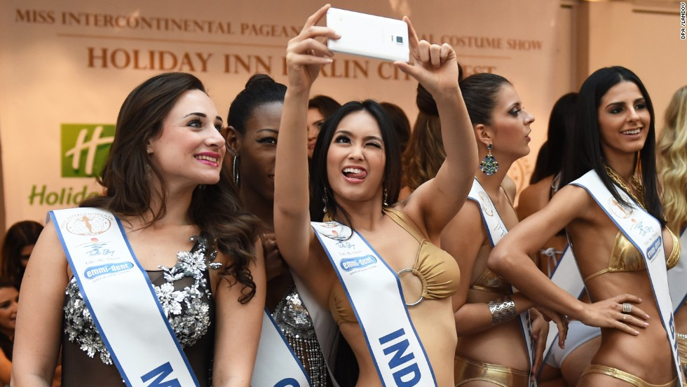 Contestants in the Miss Intercontinental pageant snap a selfie during a photo shoot Tuesday, November 25, in Berlin.