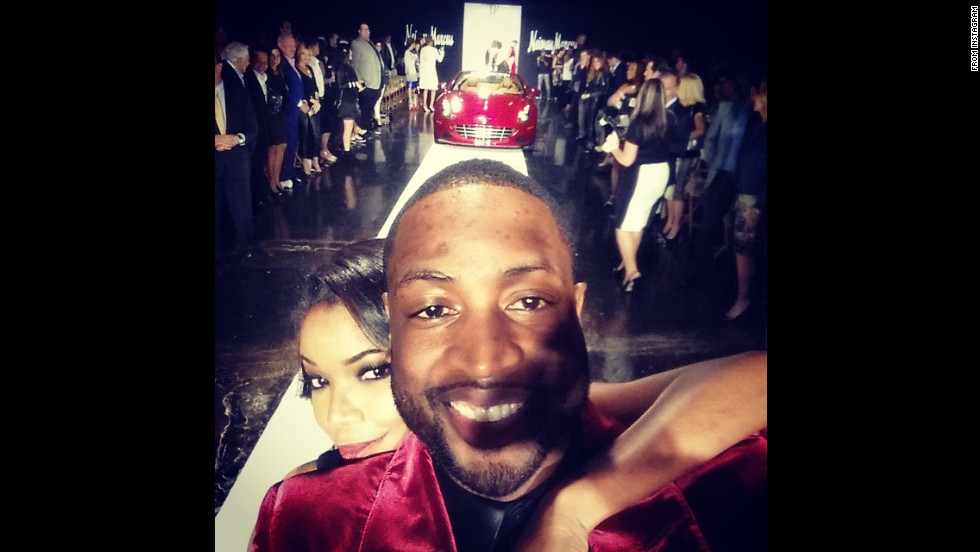 "Basketball star Dwyane Wade and his wife, actress Gabrielle Union, <a href=""http://instagram.com/p/vkQgAwlCH1/?modal=true"" target=""_blank"">pose for a selfie</a> Tuesday, November 18, during A Night on the RunWade, a fashion show in Miami that raised money for charity."