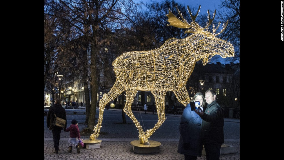 "A couple in Stockholm, Sweden, takes a selfie in front of an illuminated Christmas moose on Saturday, November 22. <a href=""http://www.cnn.com/2014/11/19/living/gallery/look-at-me-1119/index.html"">See 25 selfies from last week</a>"