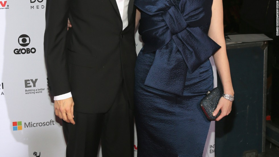 Geoffrey Arend and wife Christina Hendricks pause on the red carpet of the 2014 International Academy Of Television Arts & Sciences Emmy Awards on November 24.