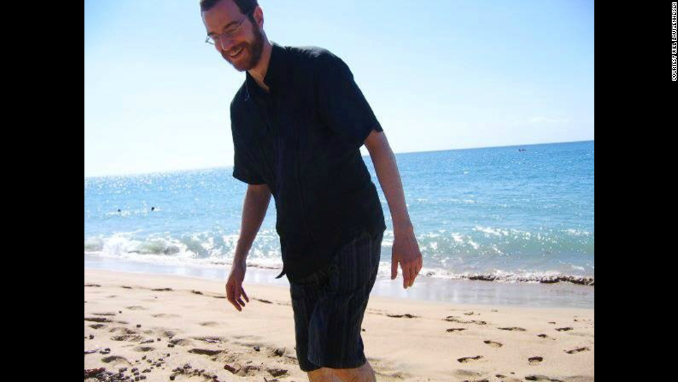 Lautzenheiser is seen above visiting a beach before his infection and loss of his limbs.