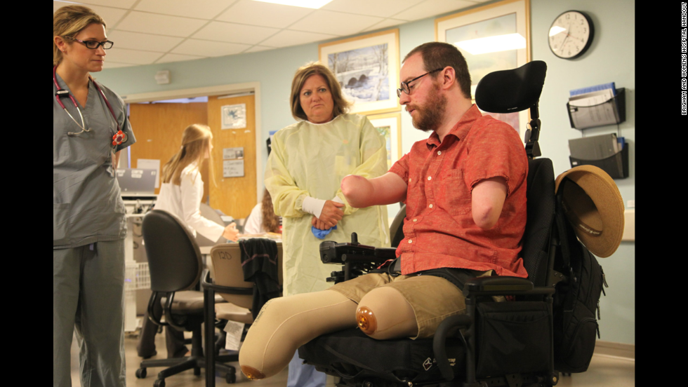 "Will Lautzenheiser, a former professor of film production and screenwriting, lost his limbs in 2011 after a battle with a severe streptococcal infection. But he received two arm transplants in Boston. ""To have come here and to have received this gift is really astonishing to me."" Here, Lautzenheiser meets with members of the plastic surgery transplant clinical care team in June 2014 at Brigham and Women's Hospital. Click through to see his remarkable medical journey:"