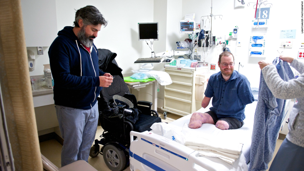 Lautzenheiser is seen in pre-op before his remarkable surgery. While his doctors said it may be years until he will be able to actually move his hands in complex ways, Lautzenheiser said he was astonished at his progress.